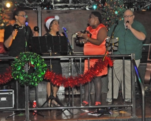 Soultivity's 5th annual Rockin' Christmas party  brings in toys, food and pet supplies